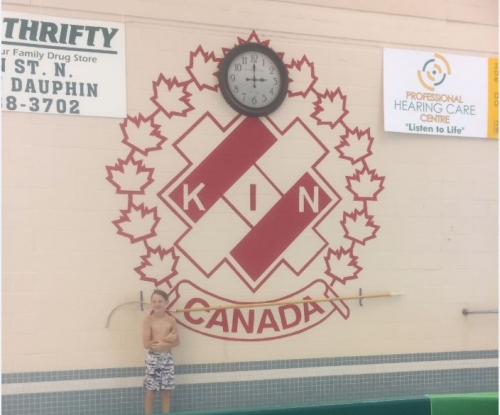 boy with kin canada logo